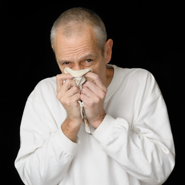 """""""Sick Man with Cold holding handkerchief"""" stock image"""