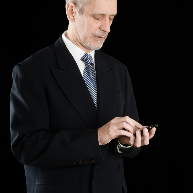 """Businessman Writing Sms on Phone"" stock image"