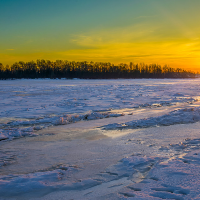 """""""Colorful Sunrise on the Frozen River"""" stock image"""