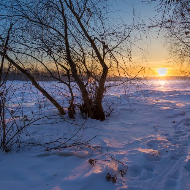"""Sunrise on the Frozen River"" stock image"