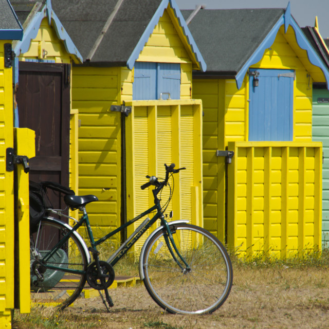"""Littlehampton beach huts and bicycle"" stock image"