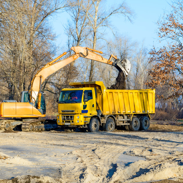 """Excavator and Lorry"" stock image"