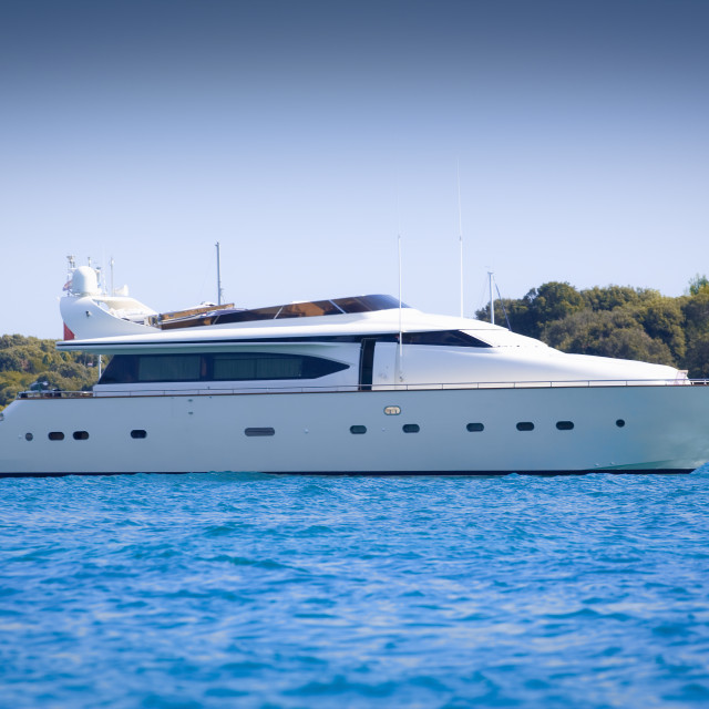 """""""Luxury yacht in a bay on a hot summer day"""" stock image"""