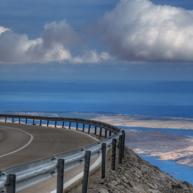"""""""Road on a mountain on a cloudy summer day"""" stock image"""