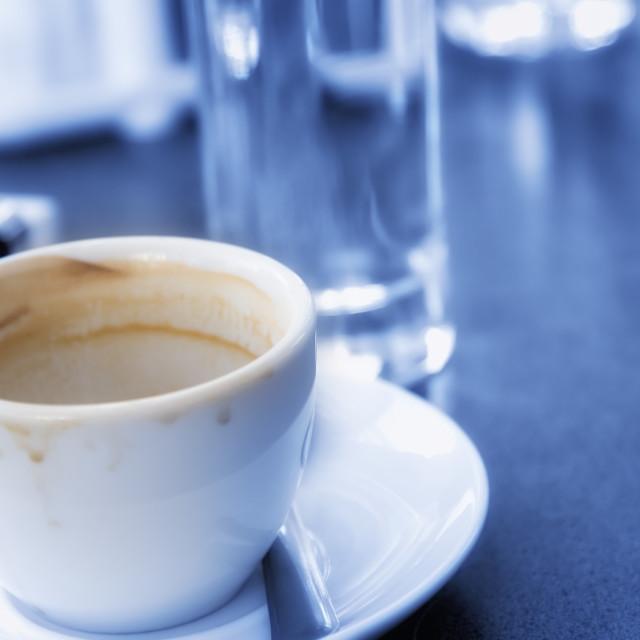 """Used coffee mug on a restaurant table"" stock image"
