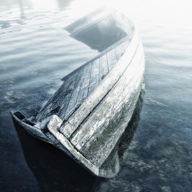 """Sunken wooden boat"" stock image"