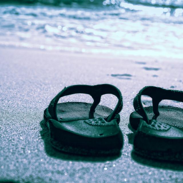 """Flip flops on a sand beach"" stock image"
