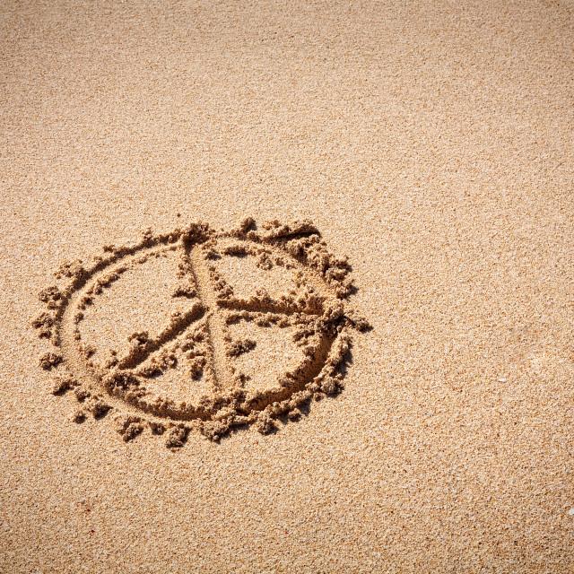 """Peace symbol on the sand beach"" stock image"