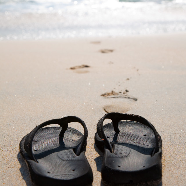 """Flip flops on a sand beach"" stock image"