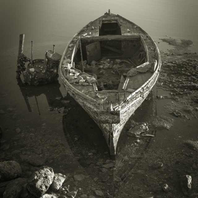 """Abandoned Wooden Boat"" stock image"