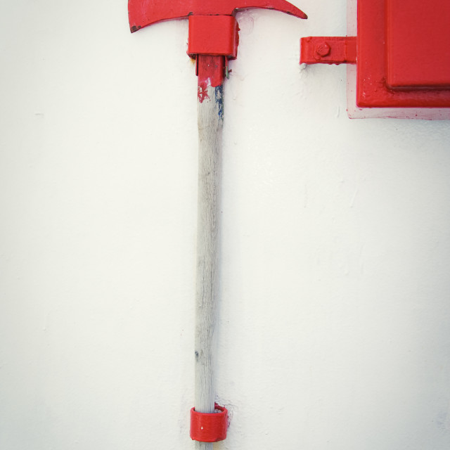 """Firefighter axe on the cruiser boat wall"" stock image"