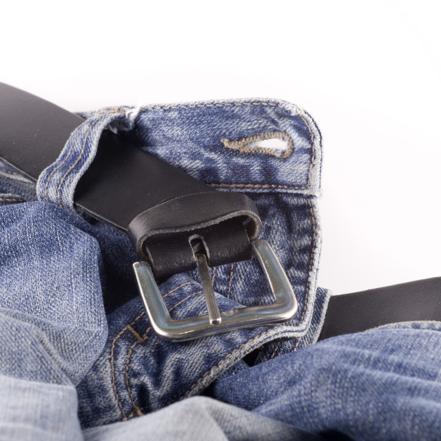 """Blue jeans and a black leather belt"" stock image"