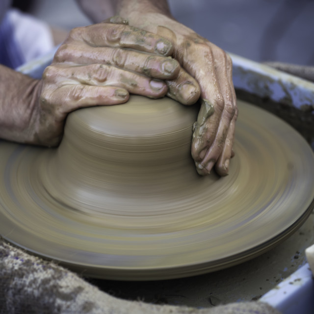 """Hands working on pottery wheel"" stock image"