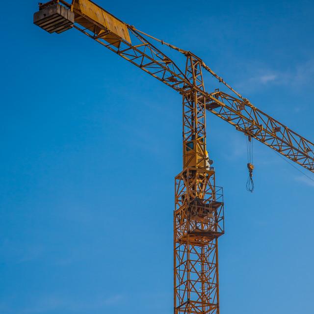 """yellow construction crane on building site"" stock image"