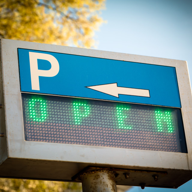 """Open... parking sign in front a parking lot"" stock image"