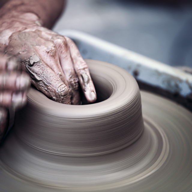 """Hands working on pottery wheel , artistic toned"" stock image"