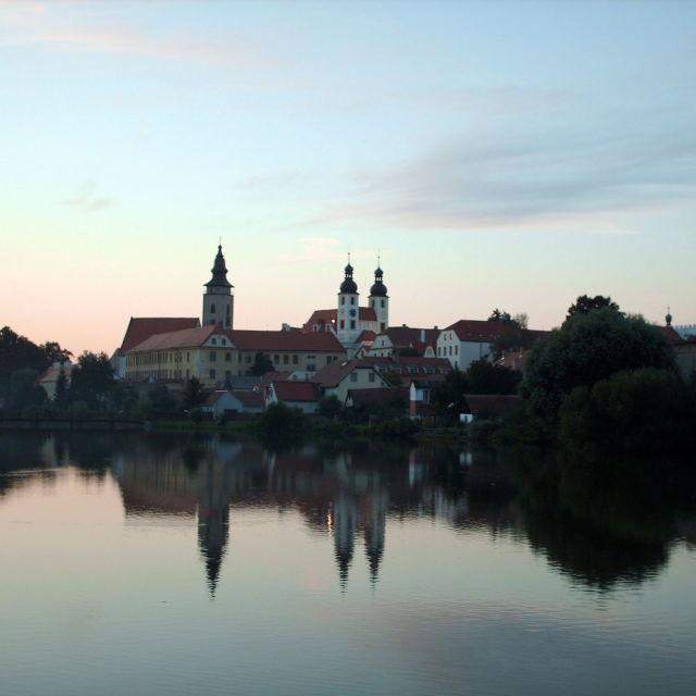 """Sun setting behind Telc, Czech republic"" stock image"