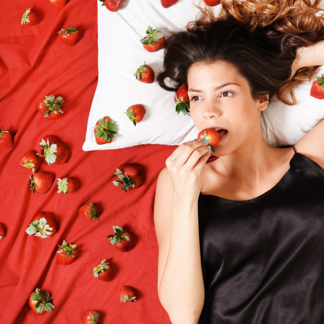 """""""Eating a Strawberry"""" stock image"""