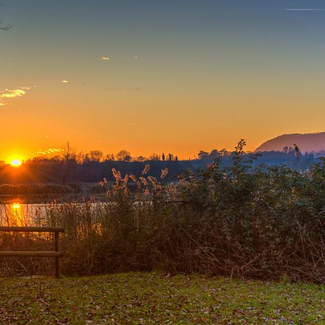 """Sunset on lake"" stock image"