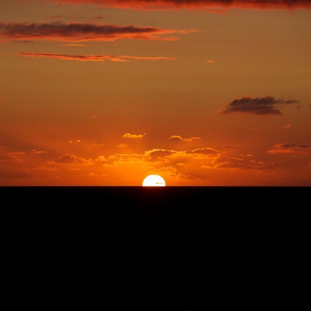 """""""Sinking Sun"""" stock image"""