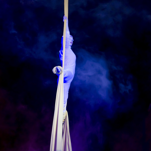 """Aerialist performs with grace"" stock image"