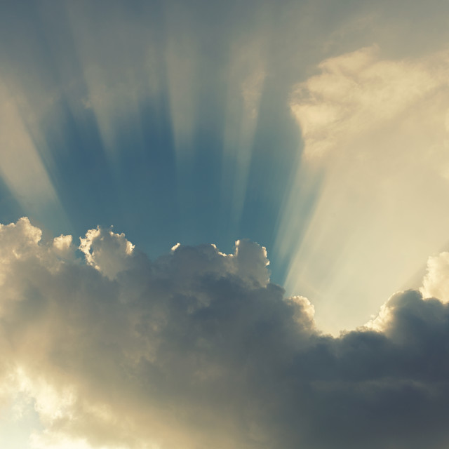 """""""Sun rays over the clouds"""" stock image"""