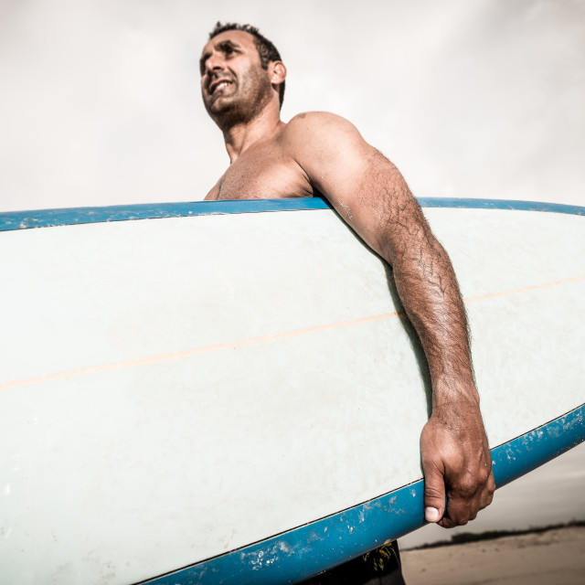 """Surfer wathing the waves"" stock image"
