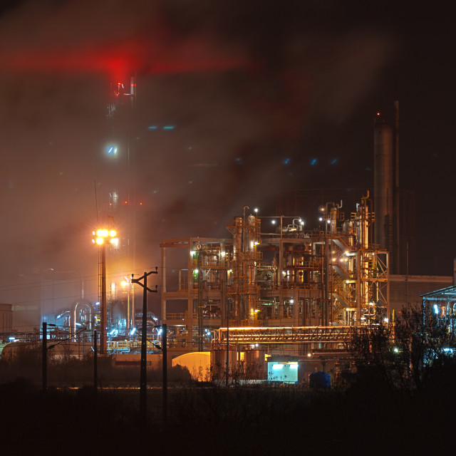 """Industrial plant at dusk"" stock image"