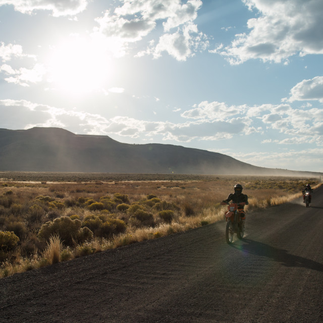 """Motorcycles on a gravel road."" stock image"