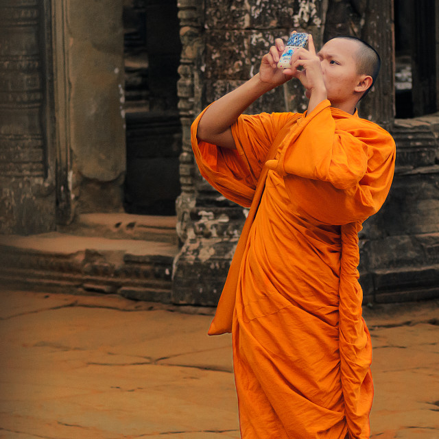 """Monk Taking a Photo"" stock image"