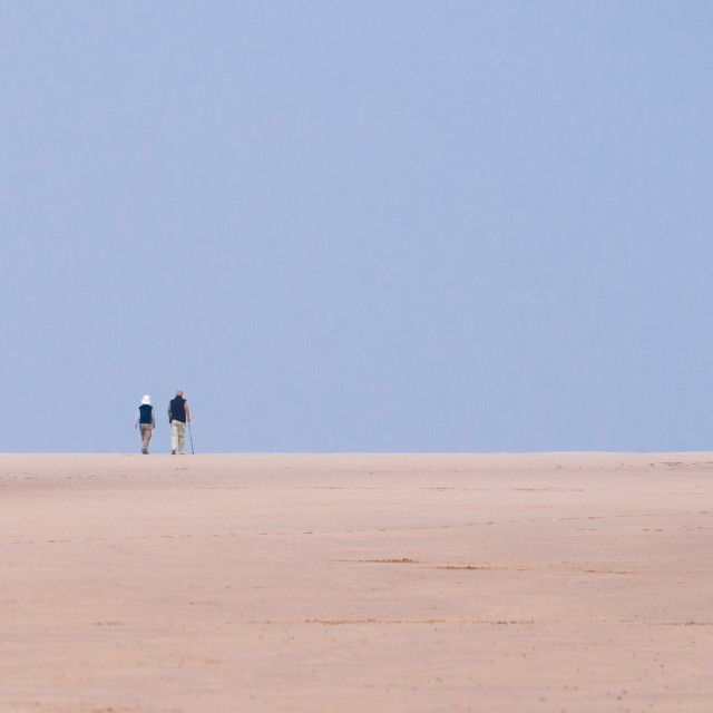 """""""old couple on deserted beach"""" stock image"""