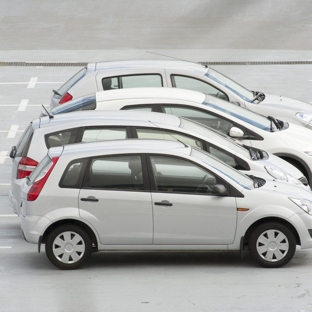"""Silver cars parked in line"" stock image"