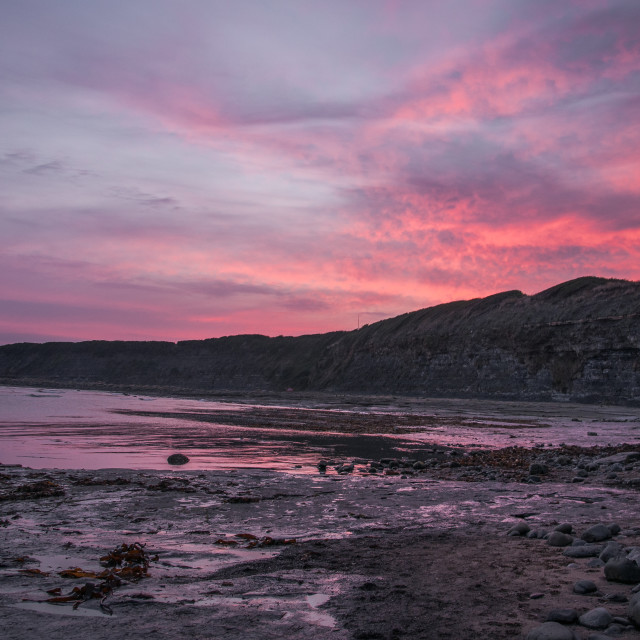 """Sun set at Kimmeridge Bay"" stock image"