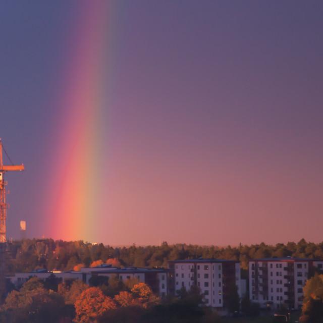 """Building crane and rainbow"" stock image"