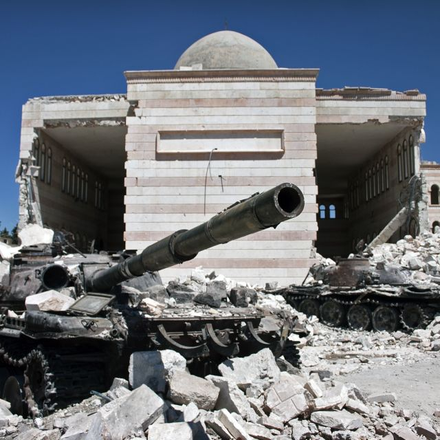 """Destroyed tank in front of mosque, Syria"" stock image"