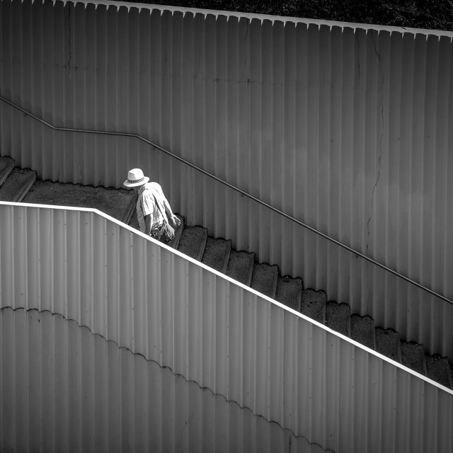 """Man Walking Up Steps ."" stock image"