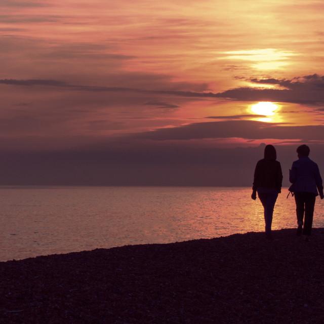 """""""Walking at Sunset"""" stock image"""