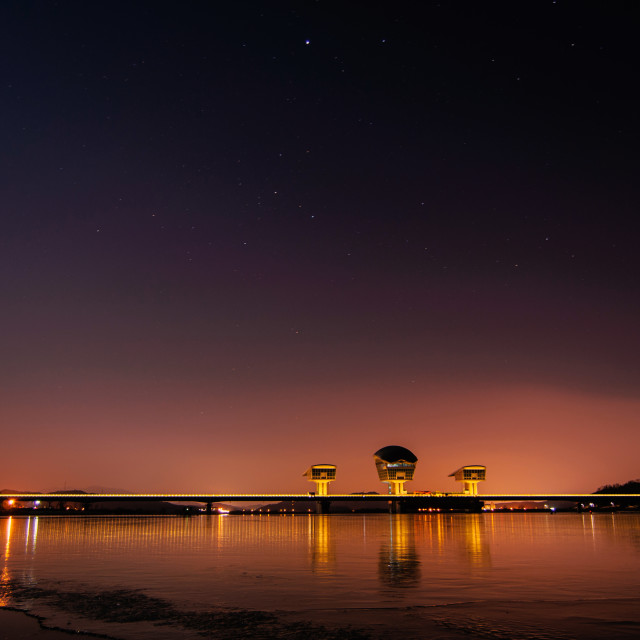 """Night view of a dam"" stock image"