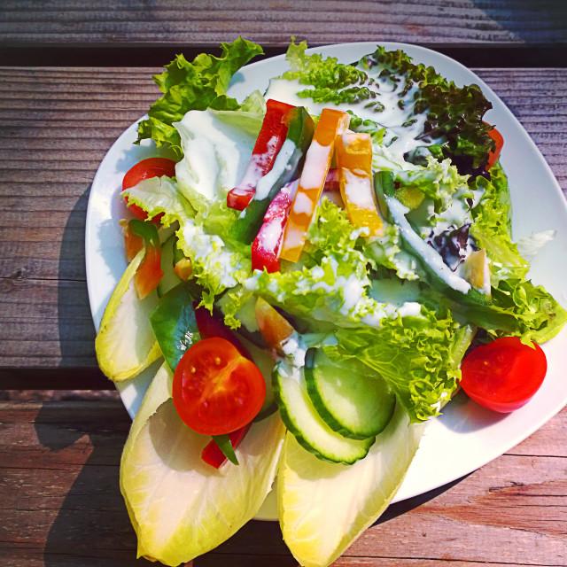 """Mixed salad with yogurt dressing"" stock image"