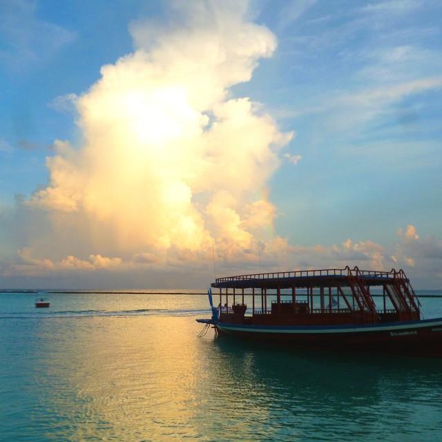 """Maldivian dhow at sunset"" stock image"