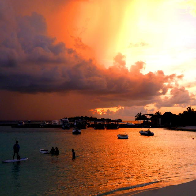 """Maldivian beach scene at sunset with incoming storm"" stock image"