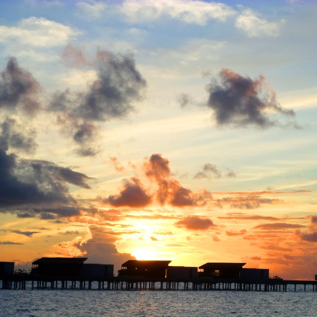 """Sunset over Maldivian water villas"" stock image"