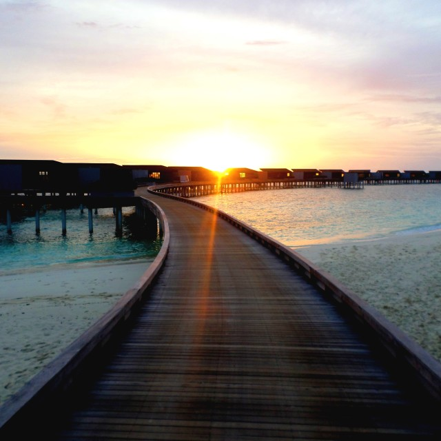 """""""Sunset over the jetty, Maldives"""" stock image"""