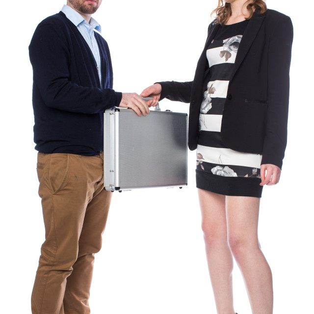 """Man receives suitcase from lady"" stock image"
