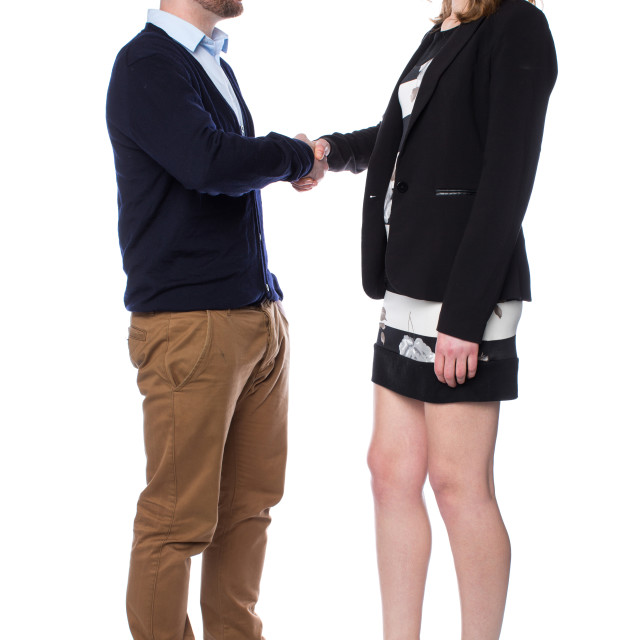 """Young man and an attractive woman shaking hands"" stock image"