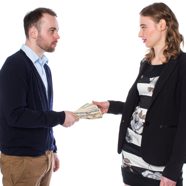 """Businessman handing money to woman"" stock image"