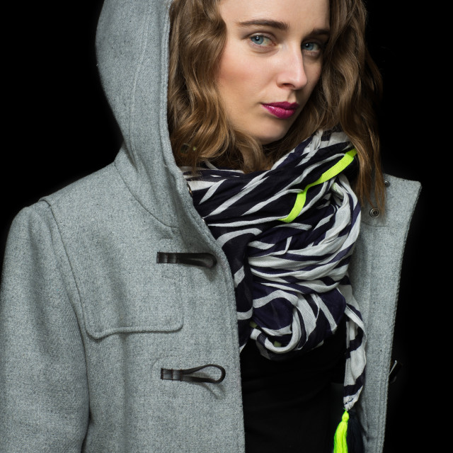 """Fashionable woman in a grey hooded coat"" stock image"