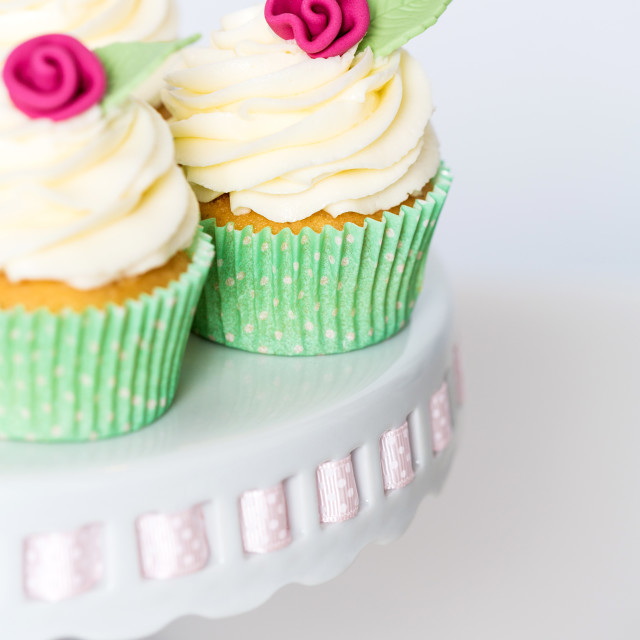 """""""Floral cupcakes on a cakestand"""" stock image"""