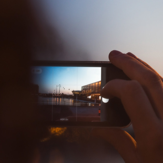 """Person photographing the sunset"" stock image"