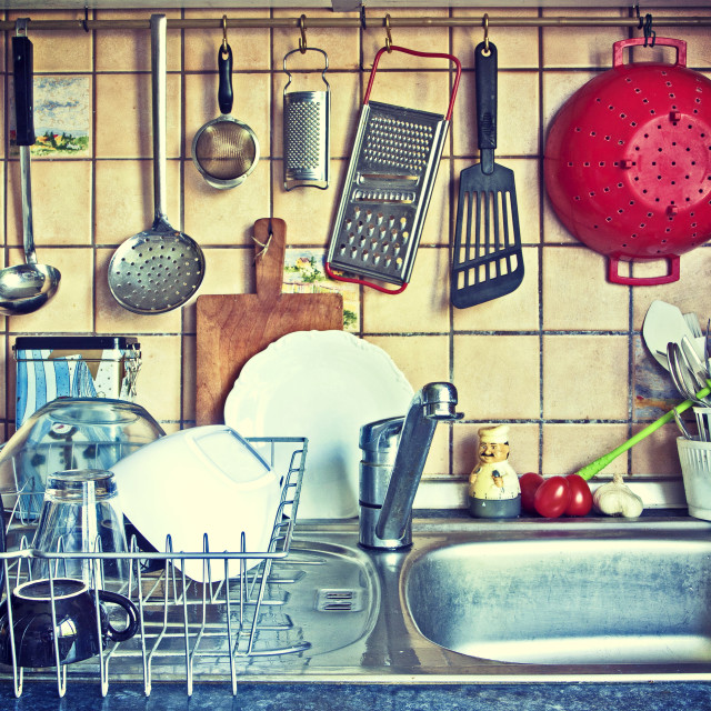 """Kitchen tools hanging on the sink"" stock image"